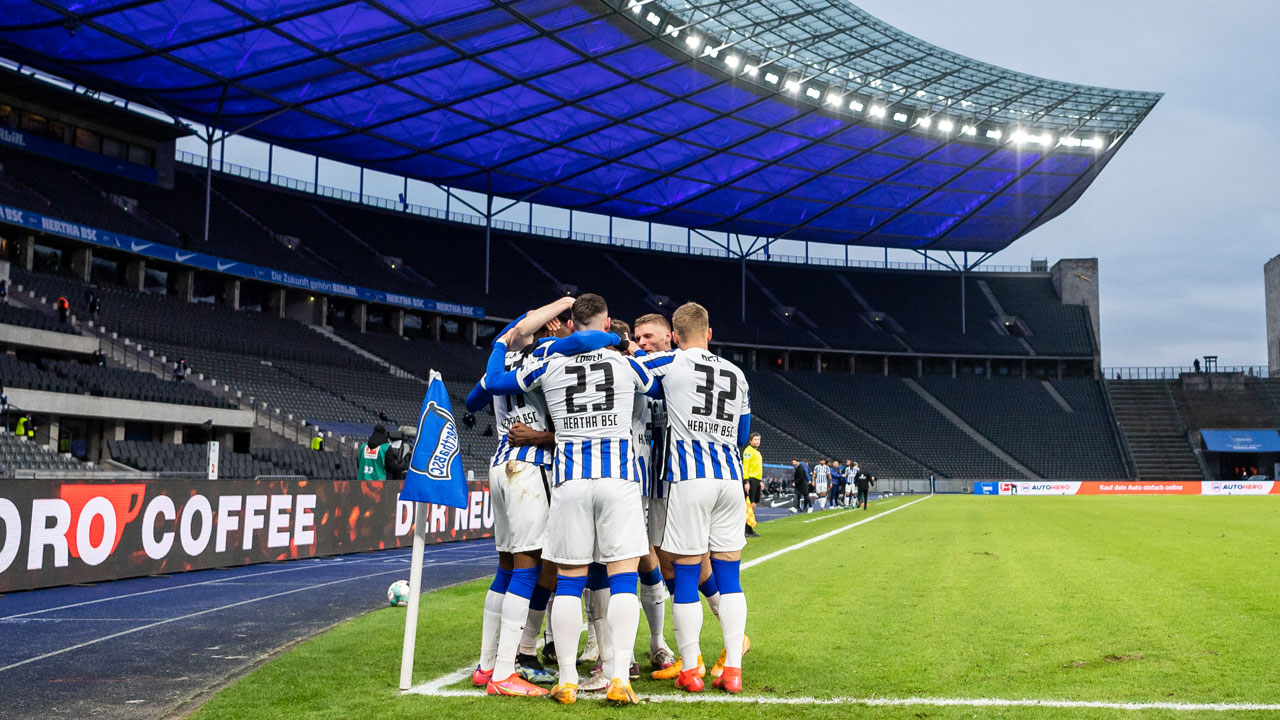 The team celebrate at the Olympiastadion.