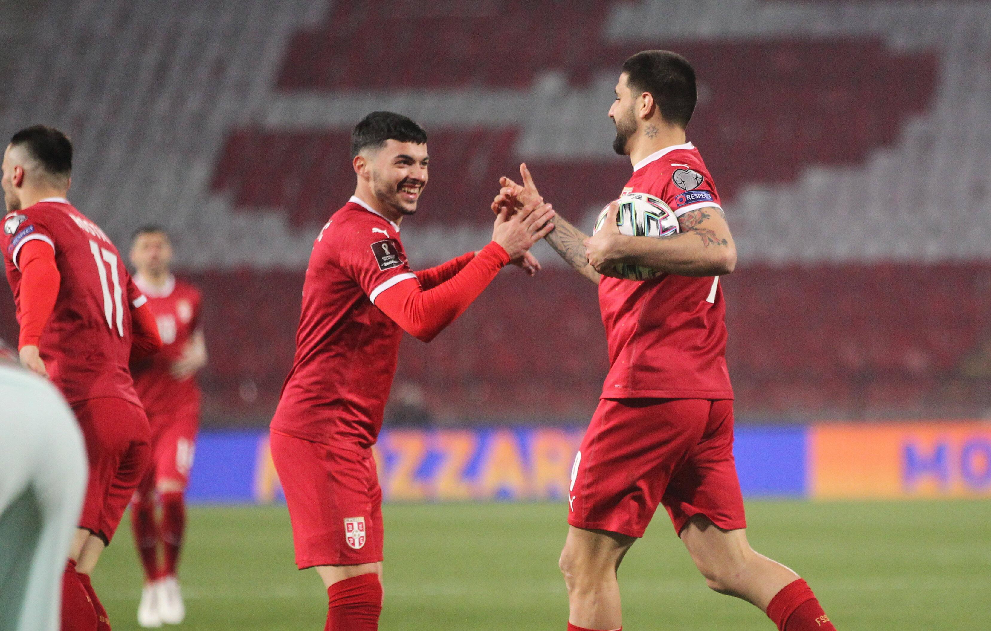 Nemanja Radonjić and  Aleksandar Mitrović celebrate a goal.