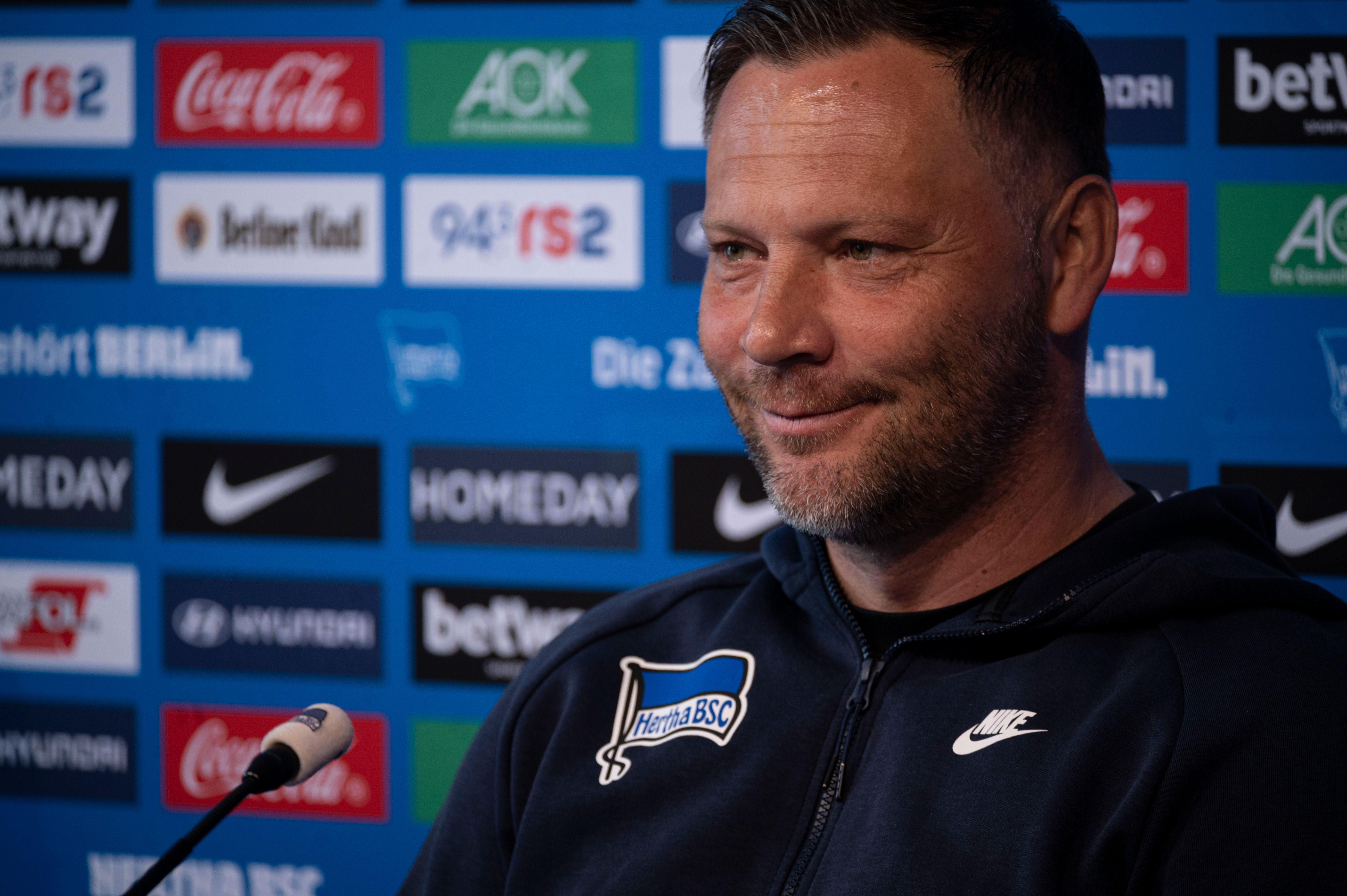 Pál Dárdai smiles at the pre-match press conference.