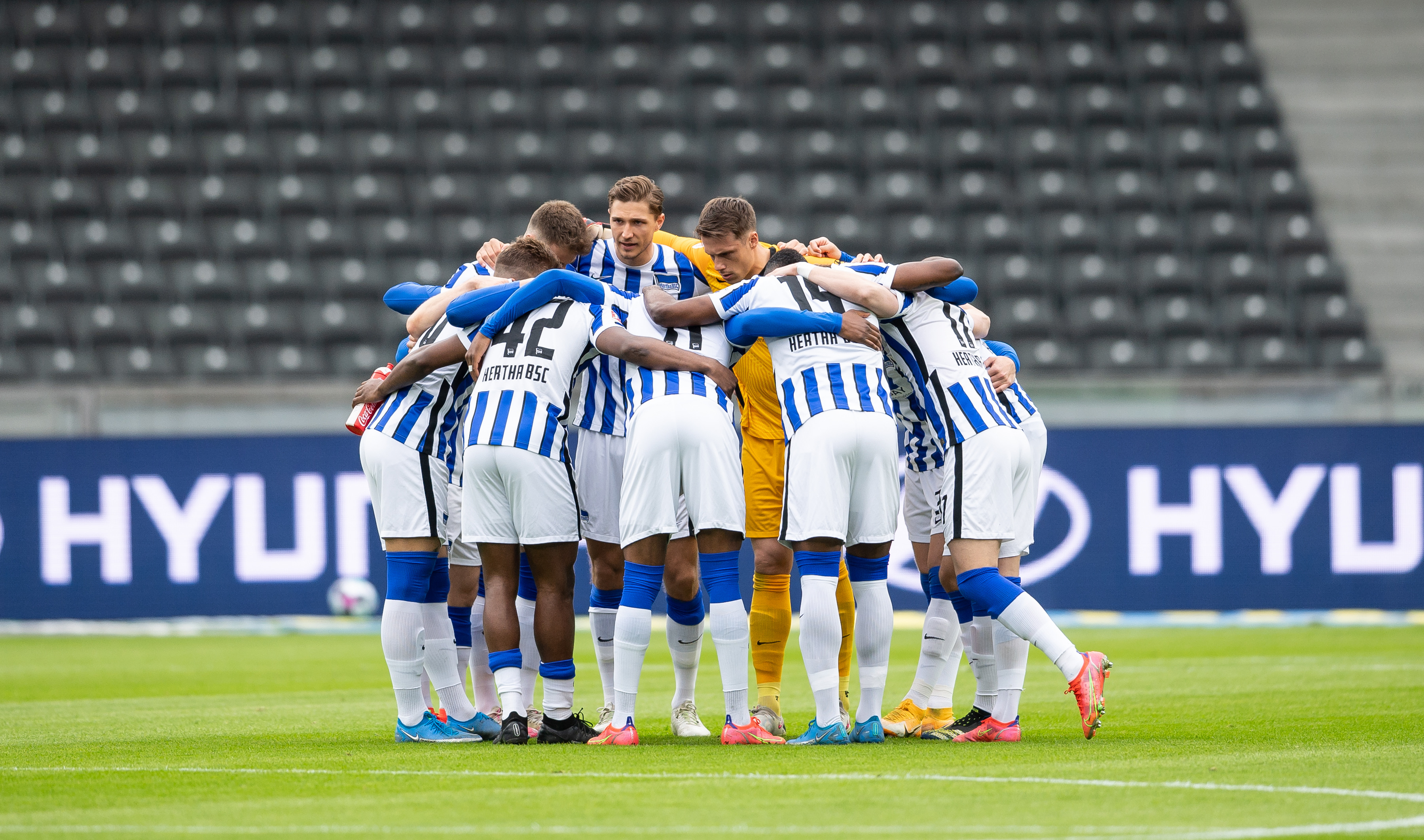 Our team huddles together before facing Mönchengladbach.