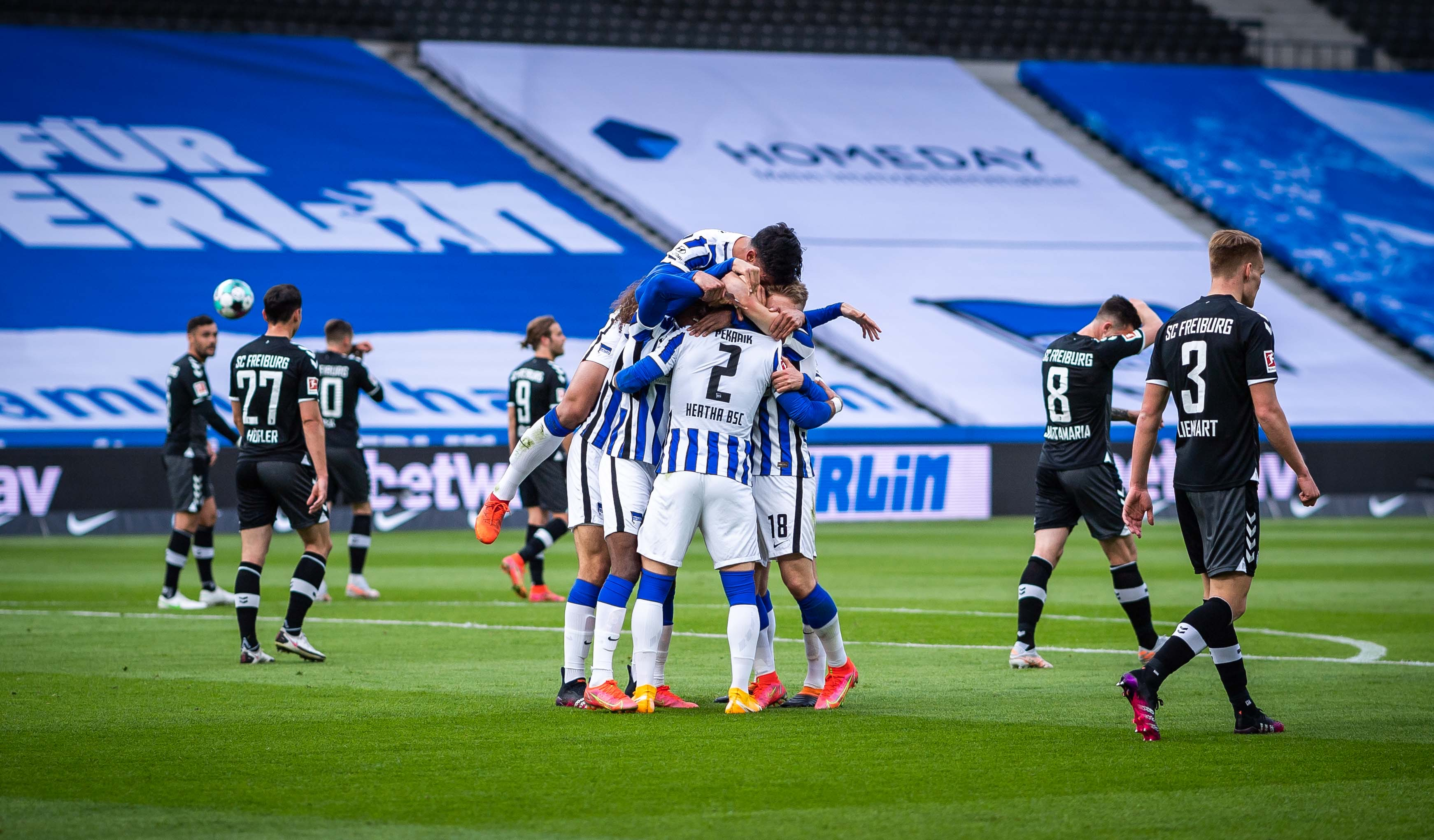 The players celebrate Hertha's second goal.