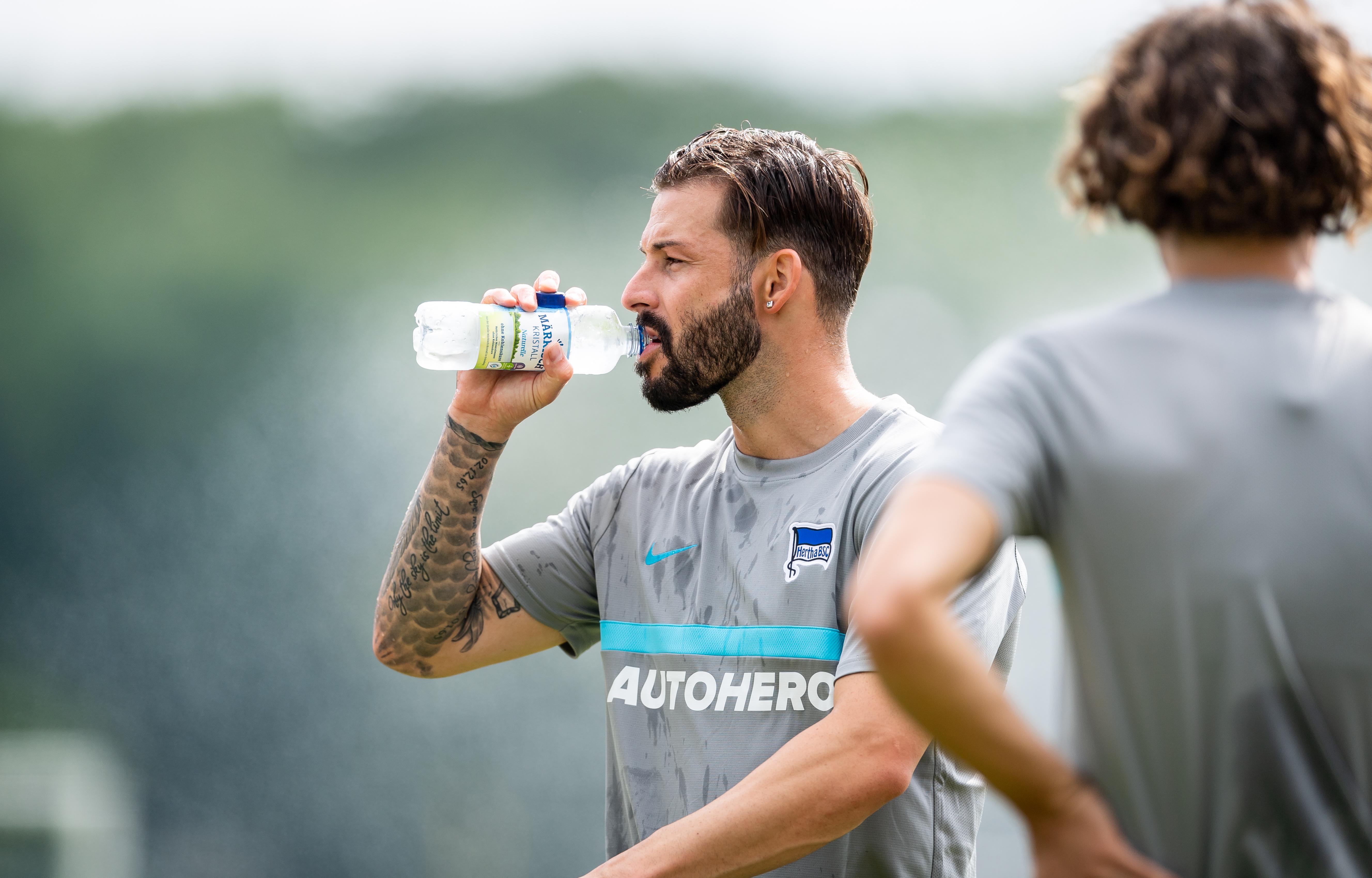 Marvin Plattenhardt drinks some water.