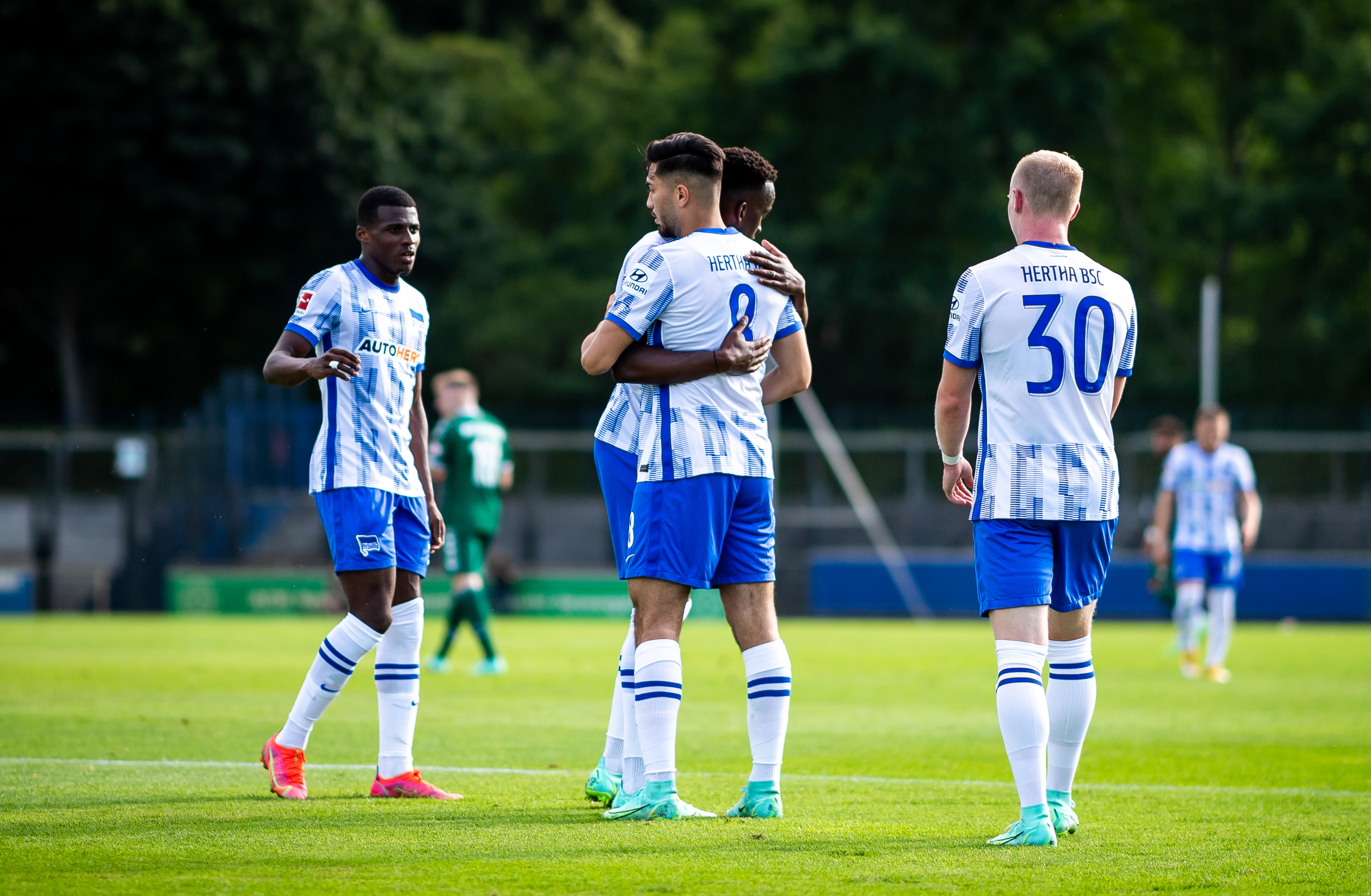 Suat Serdar and Dodi Lukébakio celebrate the former's goal.